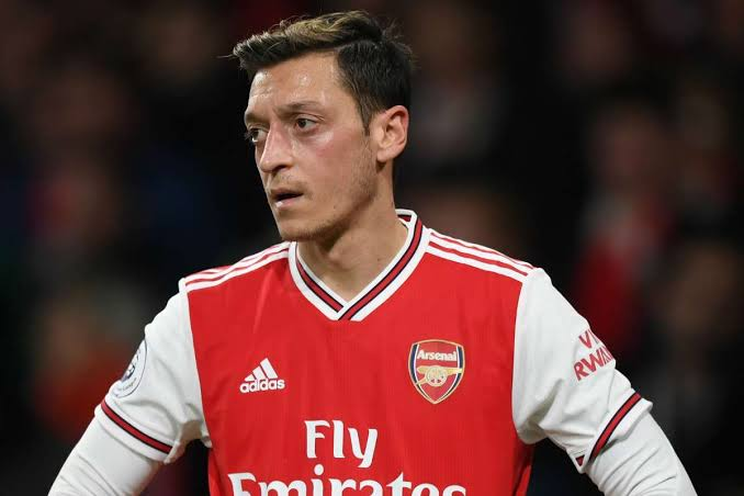 Mesut Ozil reacts after being dropped by Arteta from Arsenal's 25-man squad