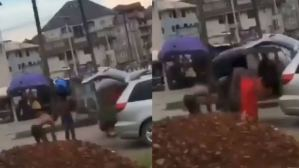 Suspected yahoo boys bath on a busy road for ritual purpose (video)