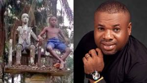 """The next generation will have no regard for the 'gods'"" – Nigerian pastor says as he shares photo of a boy sitting beside a deity in a shrine"