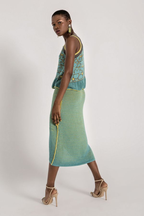 Full of charm. Textured knit tank top, with contrasting elastic straps and ruffled peplum