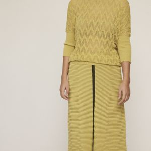 Shimmery lime knit top. Featuring round neckline, see-through motifs and 3/4 slightly puffed sleeves.