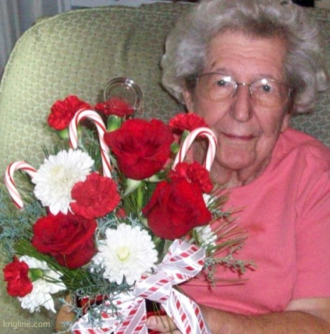 Vivian's mother with Christmas flowers, decorated with candy canes.