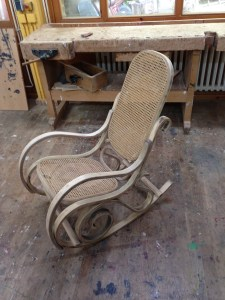 Work therapy: Teenagers work on objects like this rocking chair with the help of professional carpenters.