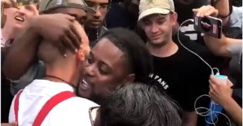 Black protester hugs white supremacist & he doesn't know what to do (VIDEO)