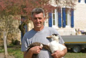 Man holding ducks in his arms