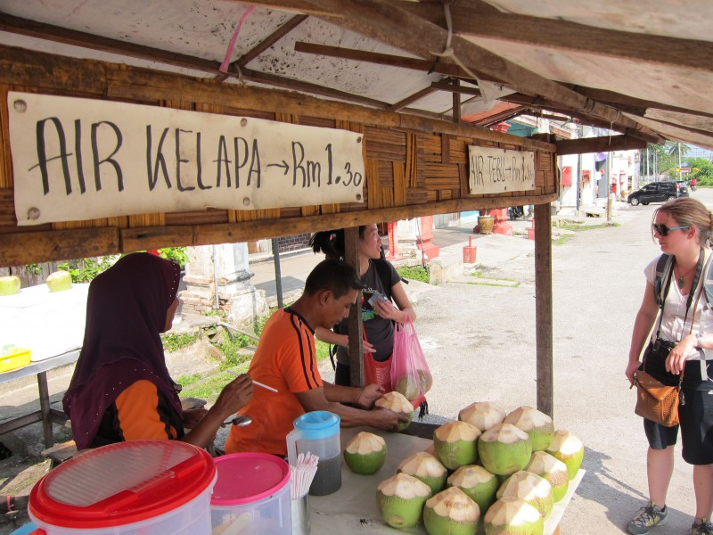 Buying a coconut and chatting to the coconut lady