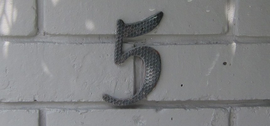 Number 5 on the front yard wall