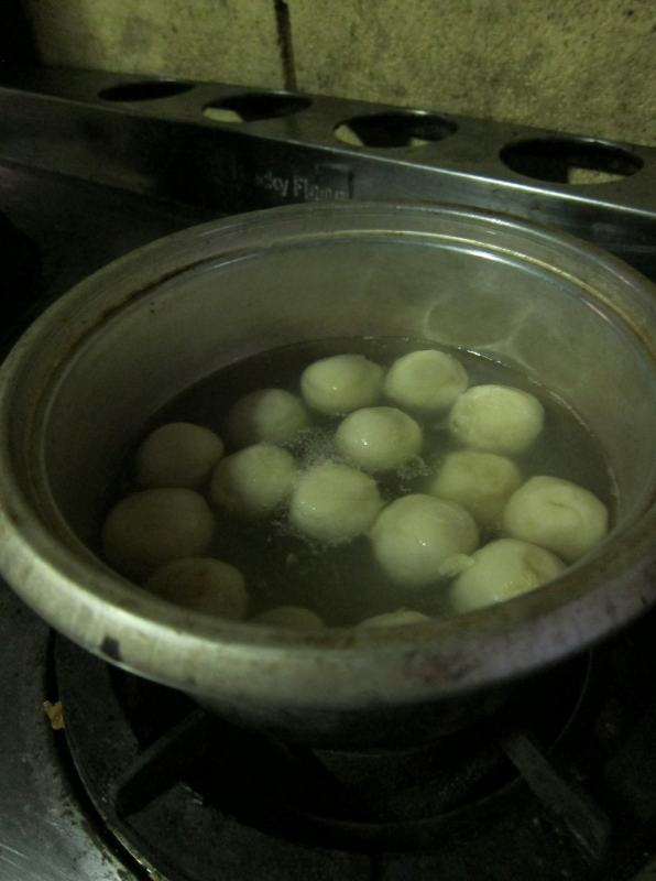 Throw your balls in boiling water. They're ready to eat when they float to the surface