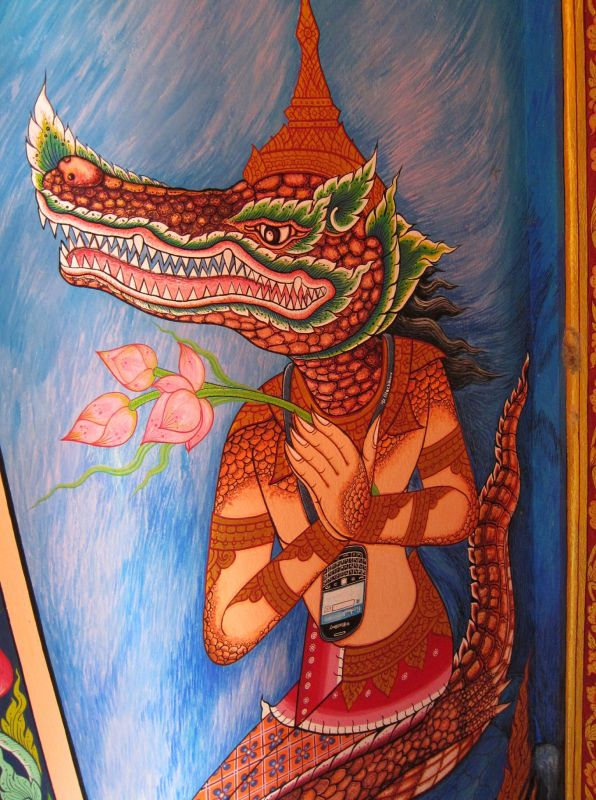 Wat Mae Ai Luang was filled with painted depictions of Buddhist mythology. This one took us by surprise - look around the creature's neck.