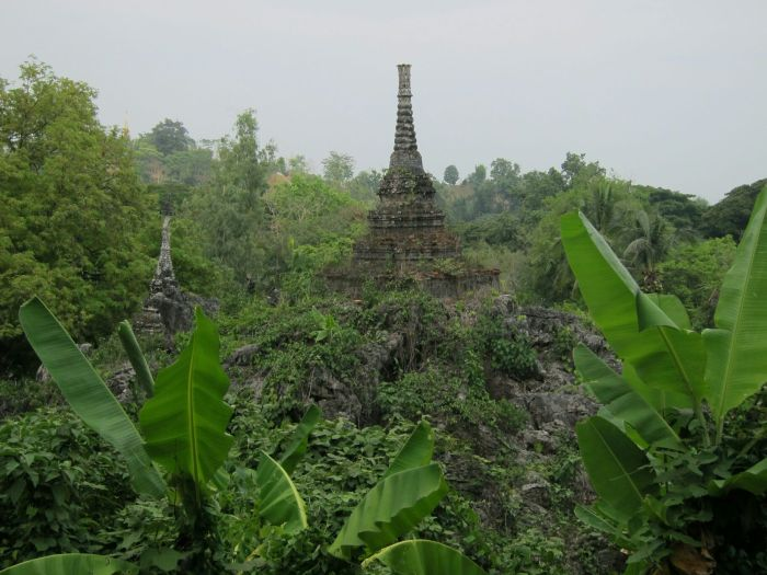Ancient stupas built on the rocks near the caves in Chiang Dao
