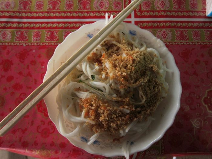 """""""Khmer Noodles' is what an English-speaker told us. They were amazing! Served cold with fresh mint and coconut milk, and when we returned the next day for more, the store was closed. $1 per bowl."""