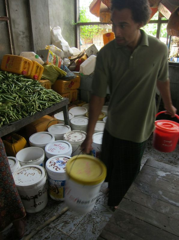 This is Calvin collecting buckets to load in the truck. He was also the driver of the truck. Calvin was a German who had been living at the centre for a year already. He was very dedicated to meditation, and had an aura of calm detachment that comes with long-term dhamma practice. In three months time he would be ordained as a monk.