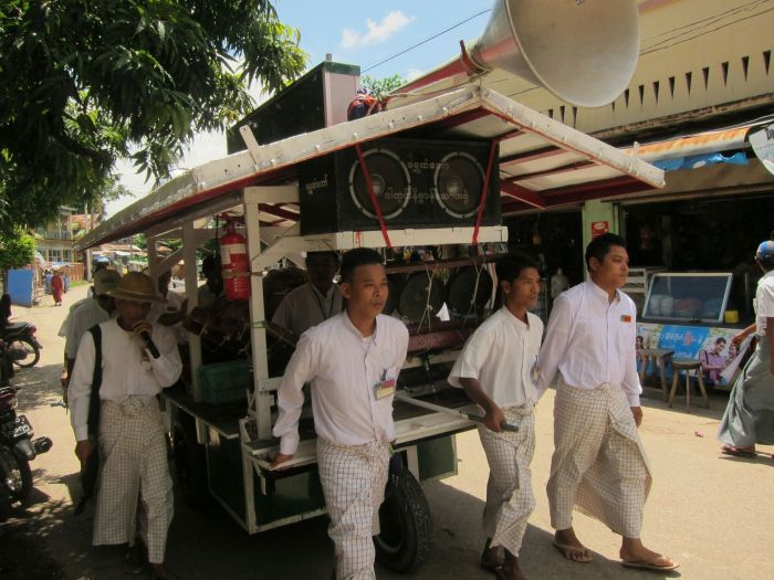 This is the start of the march. There was a small cart in front which collected the donations, this large cart in the middle, with drummers and a horn player, and a medium-sized cart at the rear hauling a generator to power the speakers, and a lot of umbrellas.