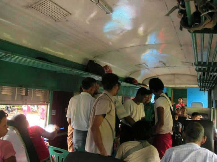 Our carriage was chaotic. People sat on the floor, on plastic chairs, on big blue barrels - whatever. Everyone laughed and gesticulated wildly, spitting betel out the windows and generally having a great time.