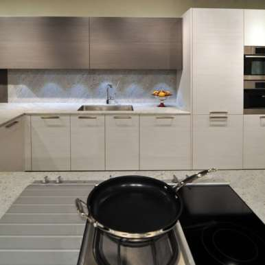contemporary warm gray and white kitchen vignette featured in eggersmann florida german kitchen showroom in the DCOTA building