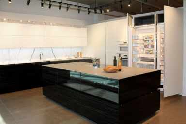 black and white kitchen by eggersmann features tons of hidden storage as seen at eggersmann florida showroom
