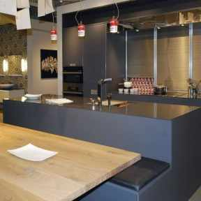 natural wood dining table with built-in banquette seating in eat-in kitchen by eggersmann on display at studio Toronto