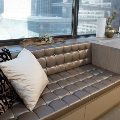 upholstered built-in settee in schmalenbach custom-designed luxury closet