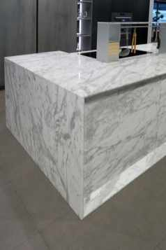 FRAME7 deep mitered edge on stone cabinet