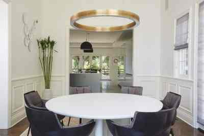 homey yet modern dining room remodel project featuring a unique brass ring chandelier as shown in modern reduction in california home magazine