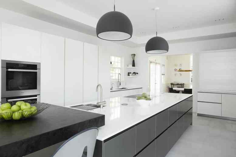 modern bright white and gray with warm wood kitchen remodel project featured in modern reduction in california home magazine