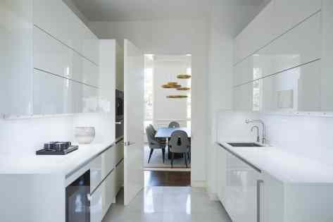 sleek white kitchen remodel project featured in modern reduction in california home magazine