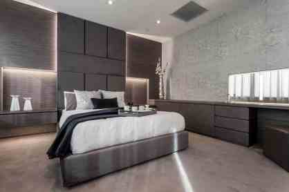 Hidden storage and interesting display niches designed by eggersmann for this bedroom