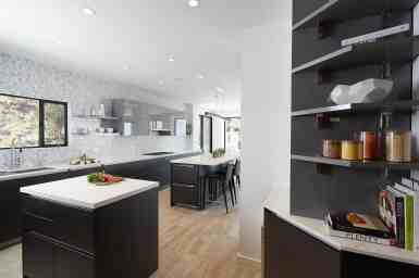 wide view including a bookshelf nook in the moussa kitchen project completed by eggersmann la
