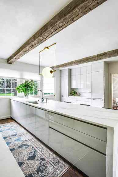 meg lonergan worked with eggersmann houston to design this ultra-modern german kitchen a Parisian apartment style remodel of a 1939 home in the Houston Museum district