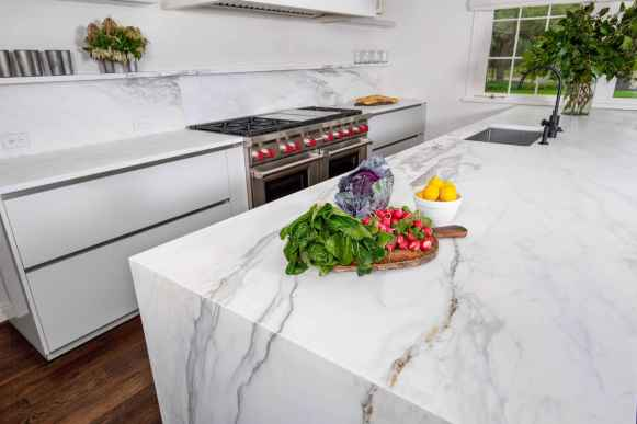 unique stone cabinetry in aria marble is the center piece of the eggersmann german kitchen featured in a remodel of a 1939 houston home