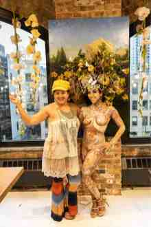 the living statue and the body paint artist rose cline who created her at the rndd gallery walk 2019 inside the eggersmann chicago showroom