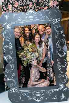 fun group poses with the living statue in photo booth in the eggersmann kitchens chicago showroom during the rndd gallery walk 2019