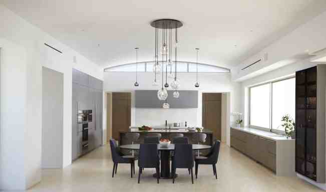 Main kitchen with luxurious dining area with German-made cabinets by eggersmann