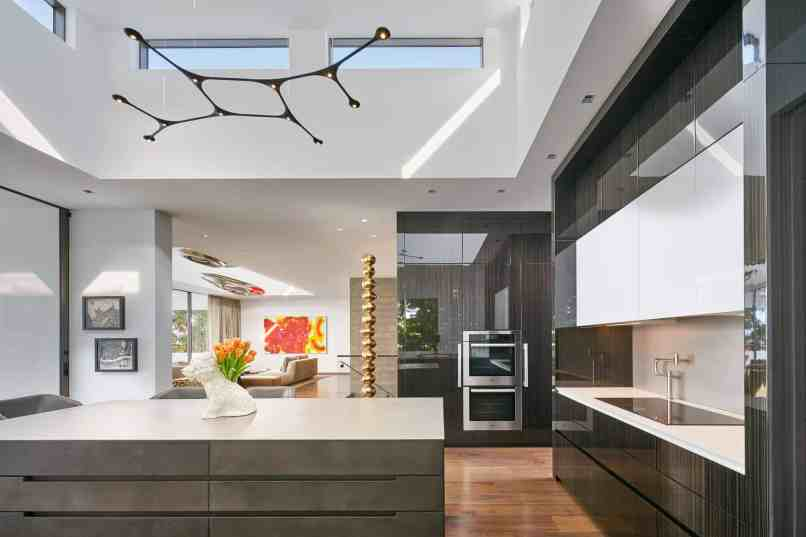 eggersmann kitchen in Fineline High Gloss Tricolor Ebony Veneer with Dark Concrete island