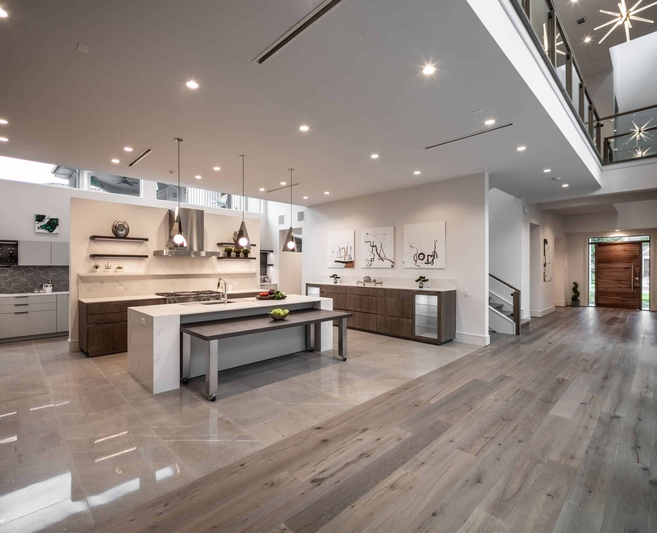 the new modern eggersmann kitchen in this a washington coalition memorial park area home in houston is off the grand foyer of this home