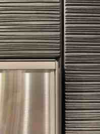 closeup detail of the dark sisal wood finish on the eggersmann NY kitchen display
