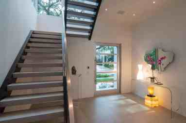 ultra modern open stairwell of master bedroom of a houston new construction home