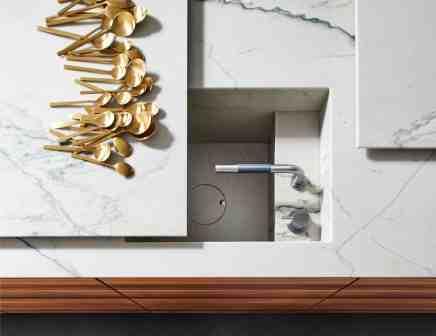eggersmann MOTION sliding countertop opens to reveal a hidden sink