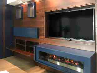 hideaway tv with luxury custom fireplace below