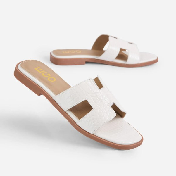 Addison Caged Flat Slider Sandal In White Croc Print Patent