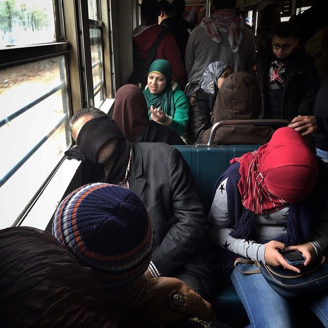 Sleeping by the window on the Metro in Cairo. Photo by Pan Chaoyue