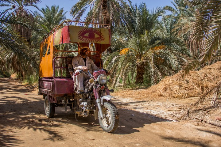 Youssef, one of many tricycle driver around the Oasis