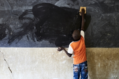 A young boy cleans the blackboard at a school in Segou, Mali, Oct 1, 2019.