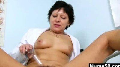 Hot Milf in nurse uniform stretching furry cunt