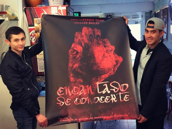 Darwin and Rinat hold the poster