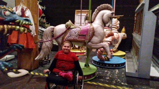 Namine backstage with one of the carousel ponies