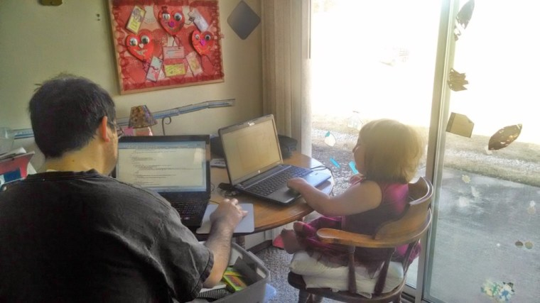 Namine and I on our computers. She had her schoolwork, and I had code to write.