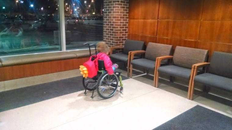 Namine spins donuts in the waiting area while the valet fetches our car.