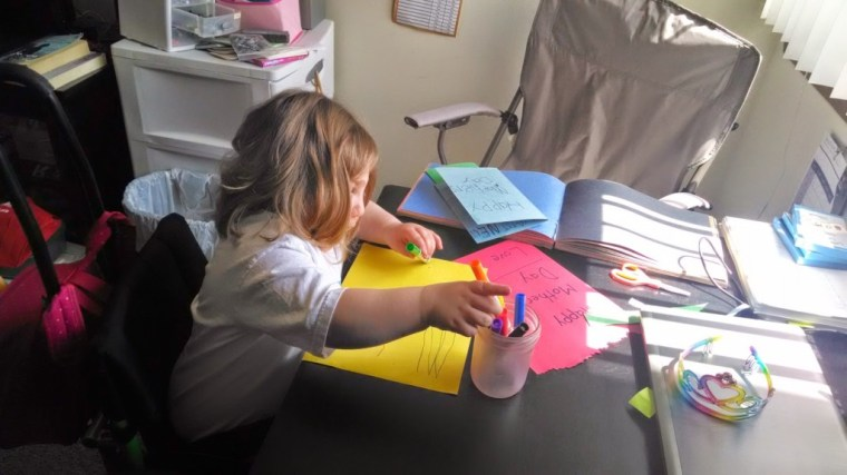 Namine works on Mother's Day cards.