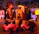 Getreu dem Rennsport-Motto der Löstige Bröder kamen Kinder des Kindergartens St. Nikolaus mit Bobbycars auf die Bühne. Foto: Reiner Züll